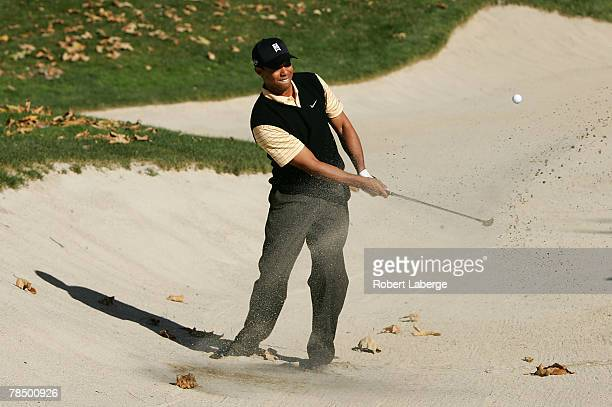 Tiger Woods makes a shot out of a bunker on the fourth hole during the third round of the Target World Challenge at the Sherwood Country Club on...
