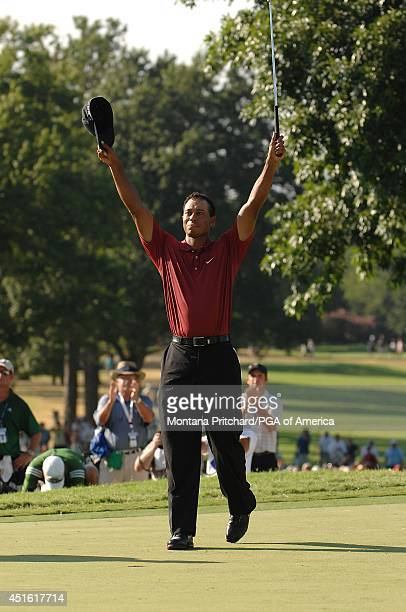 Tiger Woods makes his putt for par and to win the championship on No 18 green during the Final Round of the 89th PGA Championship held at Southern...