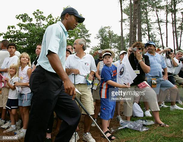 Tiger Woods makes his way past the crowd to the 11th tee during practice prior to the start of the US Open at Pinehurst Resort June 14 2005 in...