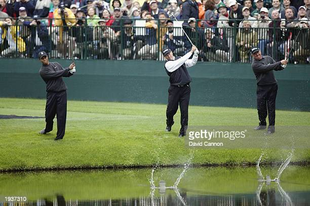 Tiger Woods Mark O'Meara and John Cook of the USA chip across the water to the green on the 16th hole during the Second practice day for the 2003...