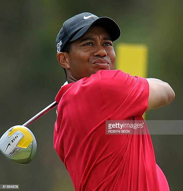 Tiger Woods of the hits on the 11th tee in his playoff match against compatriot Rocco Mediate at the 108th US Open championship at Torrey Pines Golf...