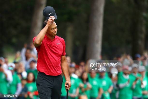 Tiger Woods of the United States acknowledges the crowd after finishing on the 18th green during the final round of World Golf Championships-Mexico...