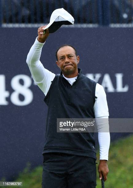 Tiger Woods of the United States acknowledges the crowd after finishing on the 18th green during the second round of the 148th Open Championship held...