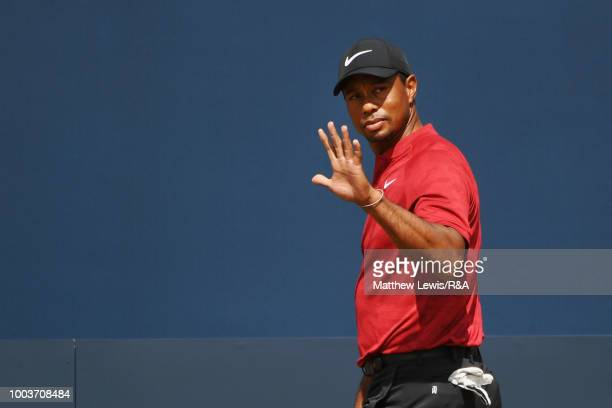 Tiger Woods of the United States acknowledges the crowd as he prepares to tee off on the 1st hole during the final round of the Open Championship at...