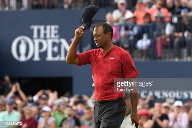 Tiger Woods of the United States acknowledges the crowd on the 18th green during the final round of the 147th Open Championship at Carnoustie Golf...