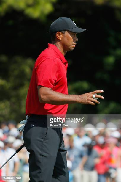 Tiger Woods of the United States acknowledges the crowd on the fifth green during the final round of the TOUR Championship at East Lake Golf Club on...