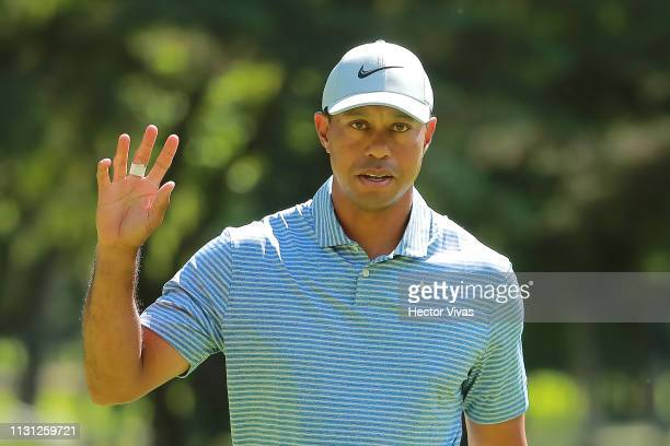 Tiger Woods of the United States acknowledges the crowd on the fifth green during the first round of World Golf Championships-Mexico Championship at...