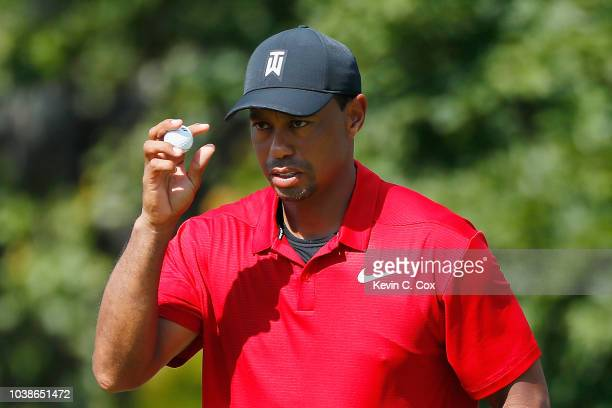 Tiger Woods of the United States acknowledges the crowd on the seventh green during the final round of the TOUR Championship at East Lake Golf Club...