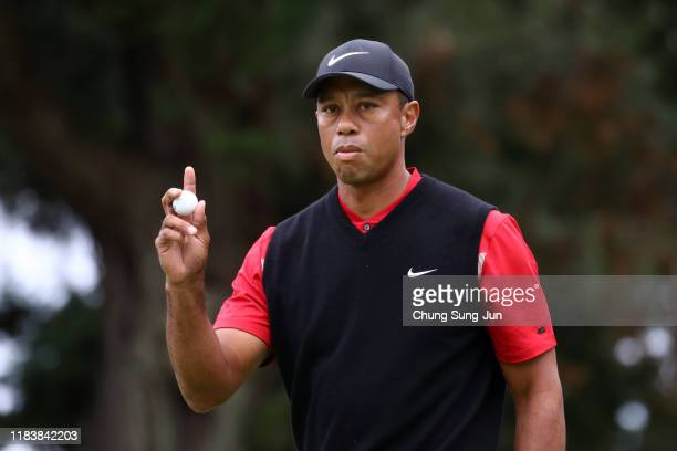 Tiger Woods of the United States acknowledges the gallery after the birdie on the 14th green during the final round of the Zozo Championship at...