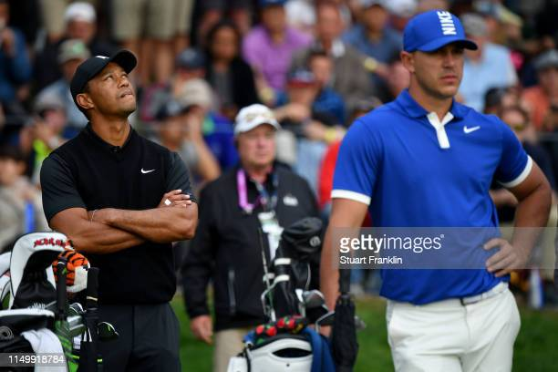 Tiger Woods of the United States and Brooks Koepka of the United States prepare to tee off on the 17th hole during the second round of the 2019 PGA...