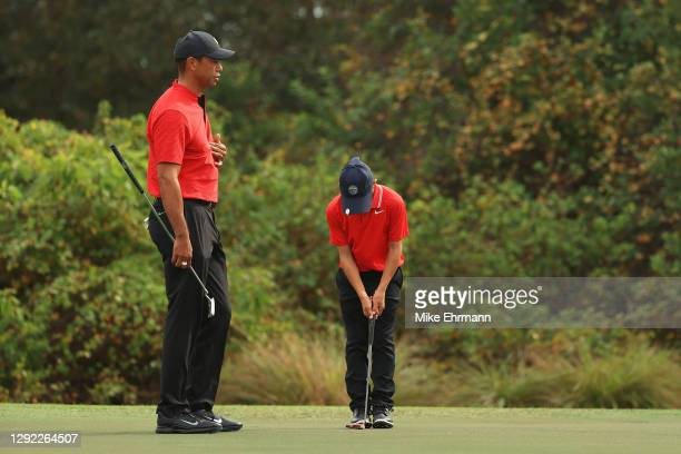 Tiger Woods of the United States and Charlie Woods prepare to putt on the seventh green during the final round of the PNC Championship at the...