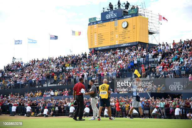 Tiger Woods of the United States and Francesco Molinari of Italy shake hands on the 18th hole green following their final round of the Open...