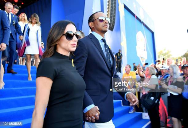 Tiger Woods of the United States and girlfriend Erica Herman depart the opening ceremony for the 2018 Ryder Cup at Le Golf National on September 27,...