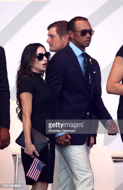 Tiger Woods of the United States and girlfriend Erica Herman depart the opening ceremony for the 2018 Ryder Cup at Le Golf National on September 27...