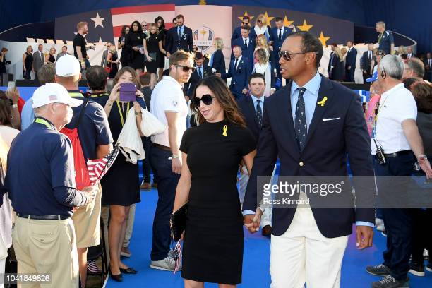 Tiger Woods of the United States and girlfriend Erica Herman during the opening ceremony for the 2018 Ryder Cup at Le Golf National on September 27...