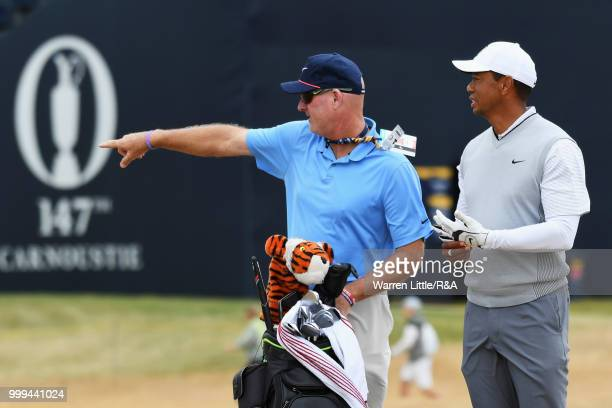 Tiger Woods of the United States and his caddie Joe LaCava seen on the 1st hole while practicing during previews to the 147th Open Championship at...