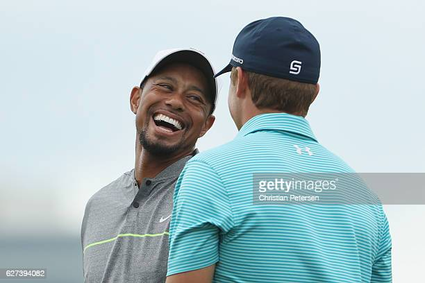 Tiger Woods of the United States and Jordan Spieth of the United States laugh on the practice range during round three of the Hero World Challenge at...