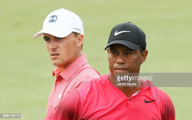 Tiger Woods of the United States and Jordan Spieth of the United States look on from the fourth hole during the final round of THE PLAYERS...