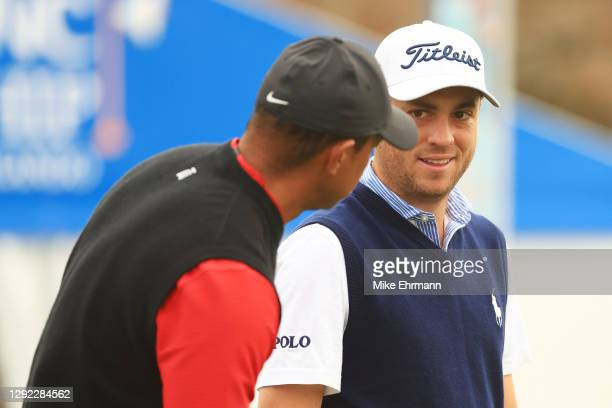 Tiger Woods of the United States and Justin Thomas of the United States talk during the final round of the PNC Championship at the Ritz-Carlton Golf...
