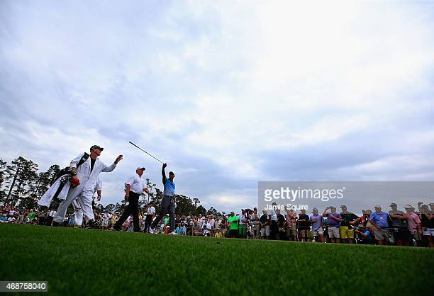 Tiger Woods of the United States and Mark O'Meara of the United States walk down the fairway during a practice round prior to the start of the 2015...