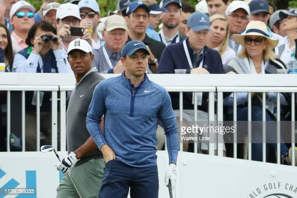 Tiger Woods of the United States and Rory McIlroy of Northern Ireland look on from the seventh tee during the fourth round of the World Golf...