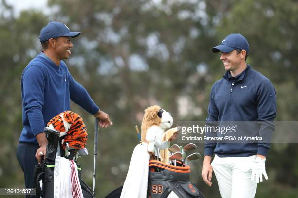 Tiger Woods of the United States and Rory McIlroy of Northern Ireland smile on the fourth tee during the first round of the 2020 PGA Championship at...