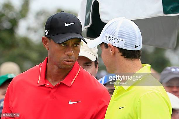 Tiger Woods of the United States and Rory McIlroy of Northern Ireland wait on the first tee during the final round of the 2015 Masters Tournament at...