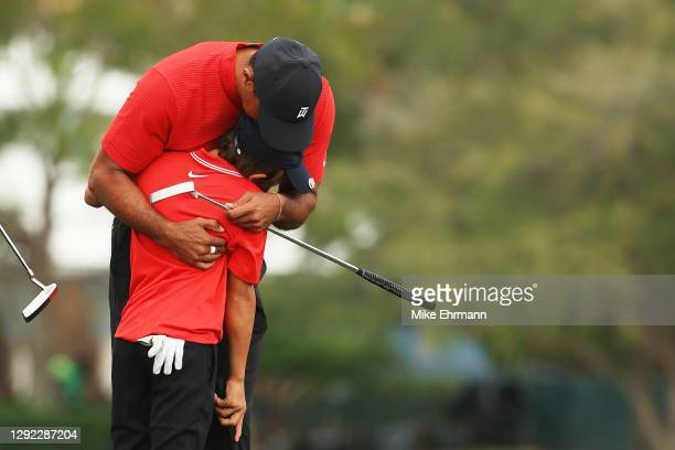 Tiger Woods of the United States and sCharlie Woods hug during the final round of the PNC Championship at the Ritz-Carlton Golf Club Orlando on...