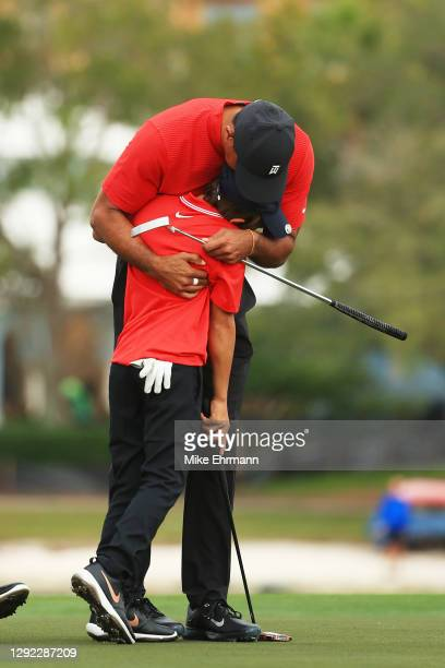 Tiger Woods of the United States and son Charlie Woods hug during the final round of the PNC Championship at the Ritz-Carlton Golf Club Orlando on...