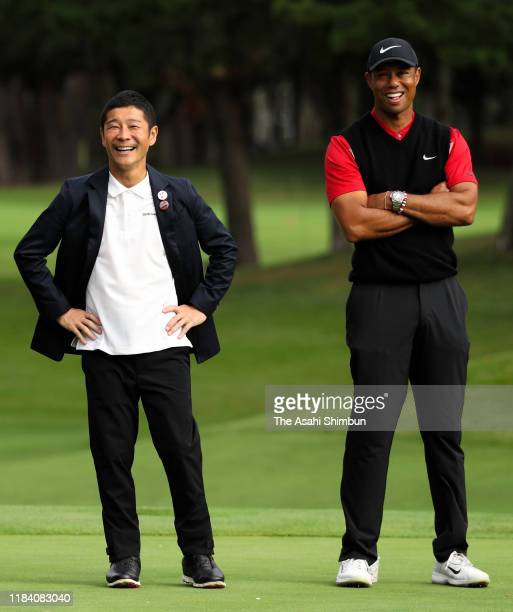 Tiger Woods of the United States and the ZOZO founder Yusaku Maezawa talk during the award ceremony following the final round of the Zozo...