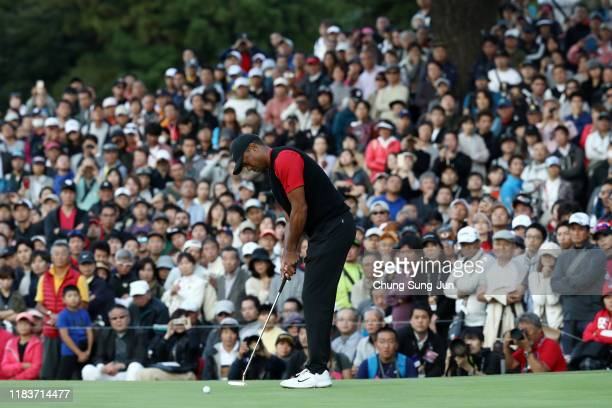 Tiger Woods of the United States attempts a putt on the 9th green during the final round of the Zozo Championship at Accordia Golf Narashino Country...