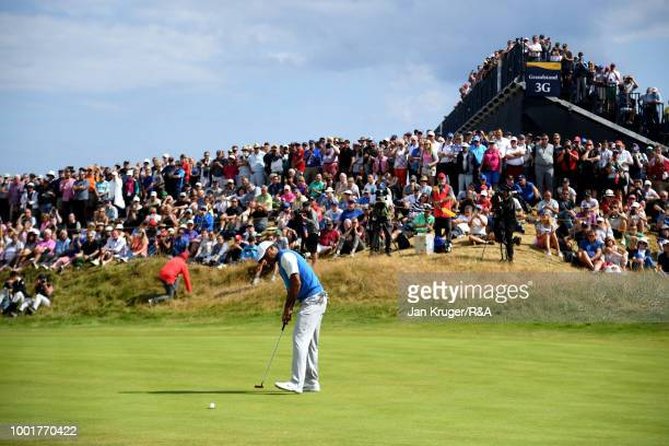 Tiger Woods of the United States birdie putts the 1st hole during round one of the 147th Open Championship at Carnoustie Golf Club on July 19 2018 in...