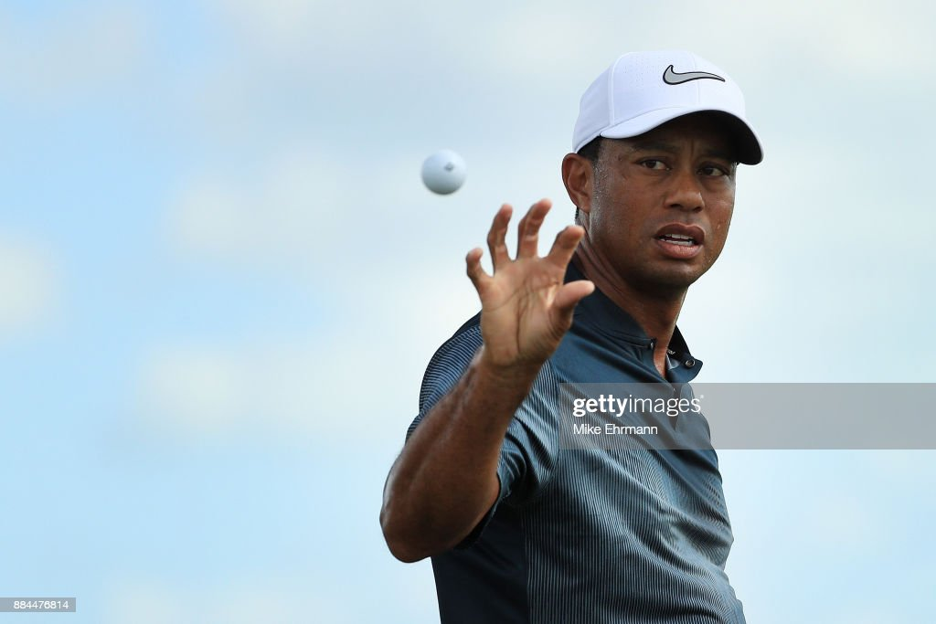 Tiger Woods of the United States catches a ball as he warms up on the range prior to the third round of the Hero World Challenge at Albany, Bahamas on December 2, 2017 in Nassau, Bahamas.