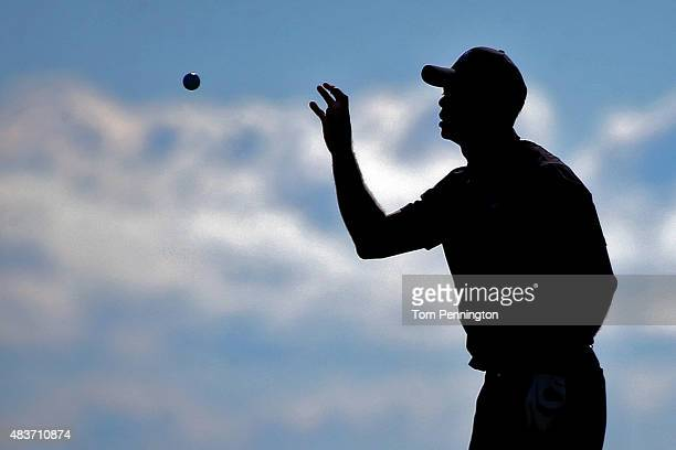 Tiger Woods of the United States catches a ball during a practice round prior to the 2015 PGA Championship at Whistling Straits on August 12 2015 in...