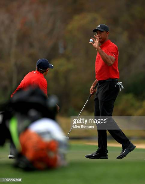 Tiger Woods of the United States catches a ball from son Charlie Woods on the 15th hole during the final round of the PNC Championship at the Ritz...