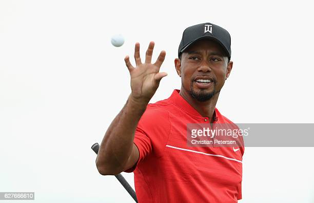 Tiger Woods of the United States catches a golf ball on the practice range during the final round of the Hero World Challenge at Albany The Bahamas...