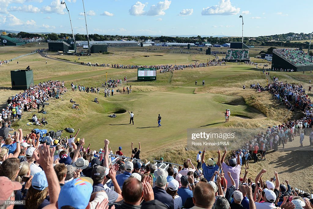 Tiger Woods of the United States celebrates a birdie on the 13th hole during the first round of the 142nd Open Championship at Muirfield on July 18, 2013 in Gullane, Scotland.