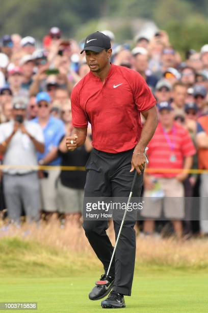 Tiger Woods of the United States celebrates a birdie on the fourth hole during the final round of the 147th Open Championship at Carnoustie Golf Club...