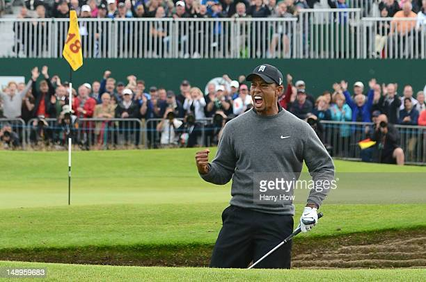 Tiger Woods of the United States celebrates after holing out from a bunker for birdie on the 18th hole during the second round of the 141st Open...