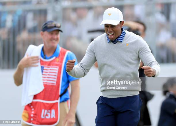 Tiger Woods of the United States celebrates after Justin Thomas had holed a birdie putt to win their match against Hideki Matsuyama and Byeong Hun An...