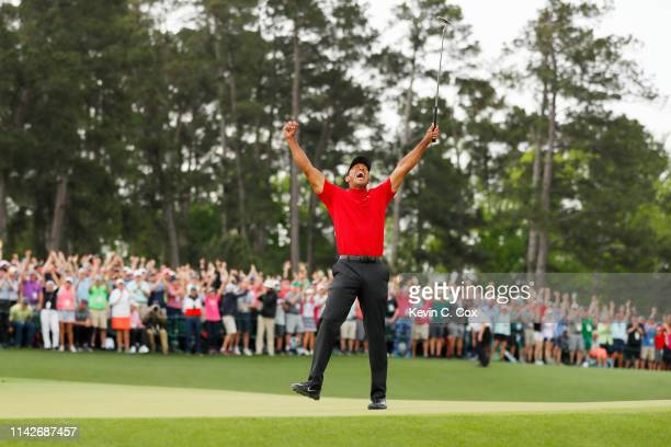 Tiger Woods of the United States celebrates after making his putt on the 18th green to win the Masters at Augusta National Golf Club on April 14 2019...