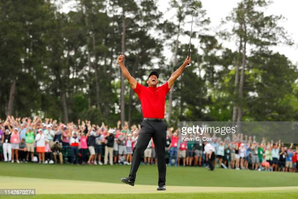Tiger Woods of the United States celebrates after sinking his putt to win during the final round of the Masters at Augusta National Golf Club on...