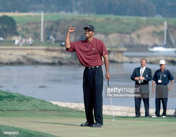 Tiger Woods of the United States celebrates after winning the US Open Golf Championship held at the Pebble Beach Golf Links in California 18th June...