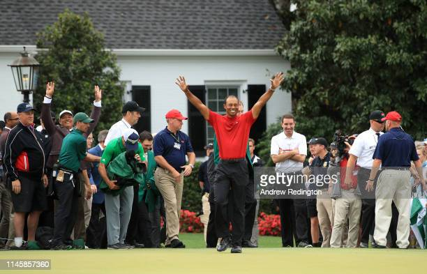 Tiger Woods of the United States celebrates during the Green Jacket Ceremony after winning the Masters at Augusta National Golf Club on April 14,...