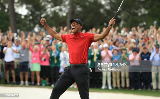 Tiger Woods of the United States celebrates on the 18th green after winning the Masters at Augusta National Golf Club on April 14, 2019 in Augusta,...