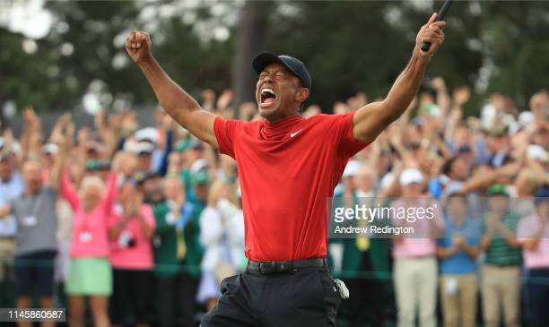Tiger Woods of the United States celebrates on the 18th green after winning the Masters at Augusta National Golf Club on April 14 2019 in Augusta...