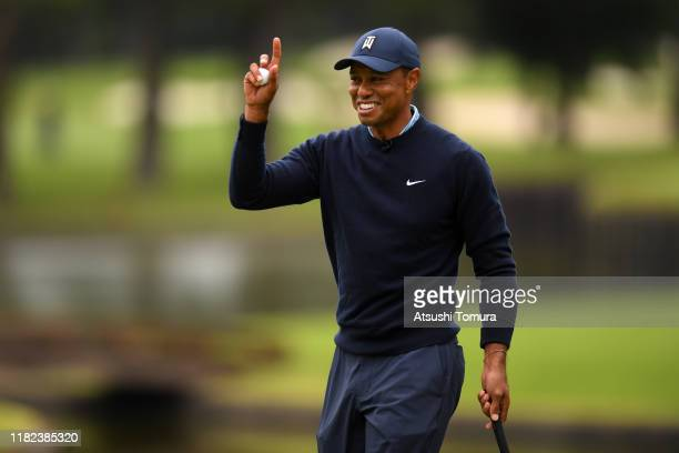 Tiger Woods of the United States celebrates on the 6th green during The Challenge: Japan Skins at Accordia Golf Narashino Country Club on October 21,...
