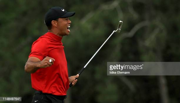 Tiger Woods of the United States celebrates winning the Masters during the final roubnd at Augusta National Golf Club on April 14, 2019 in Augusta,...