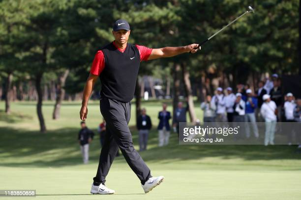 Tiger Woods of the United States celebrates winning the tournament on the 18th green during the final round of the Zozo Championship at Accordia Golf...