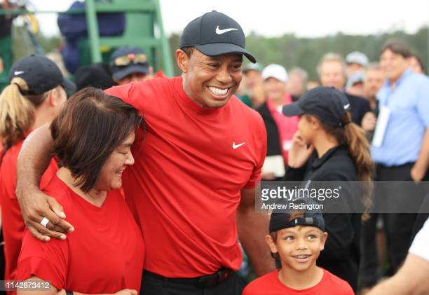 Tiger Woods of the United States celebrates with his son Charlie Axel as he comes off the 18th hole in honor of his win during the final round of the...